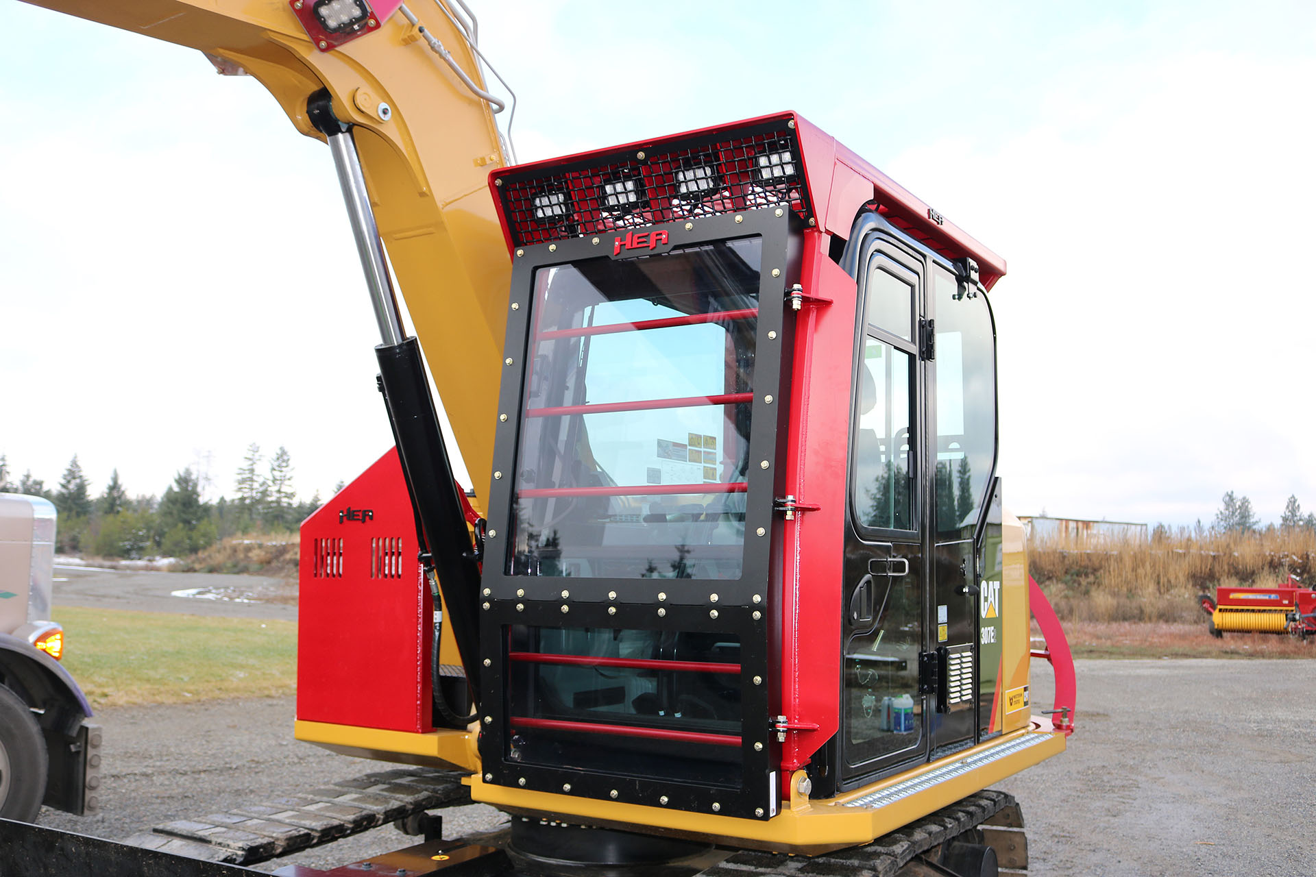 Cat 307E2 with Ballistic Logger Style Window