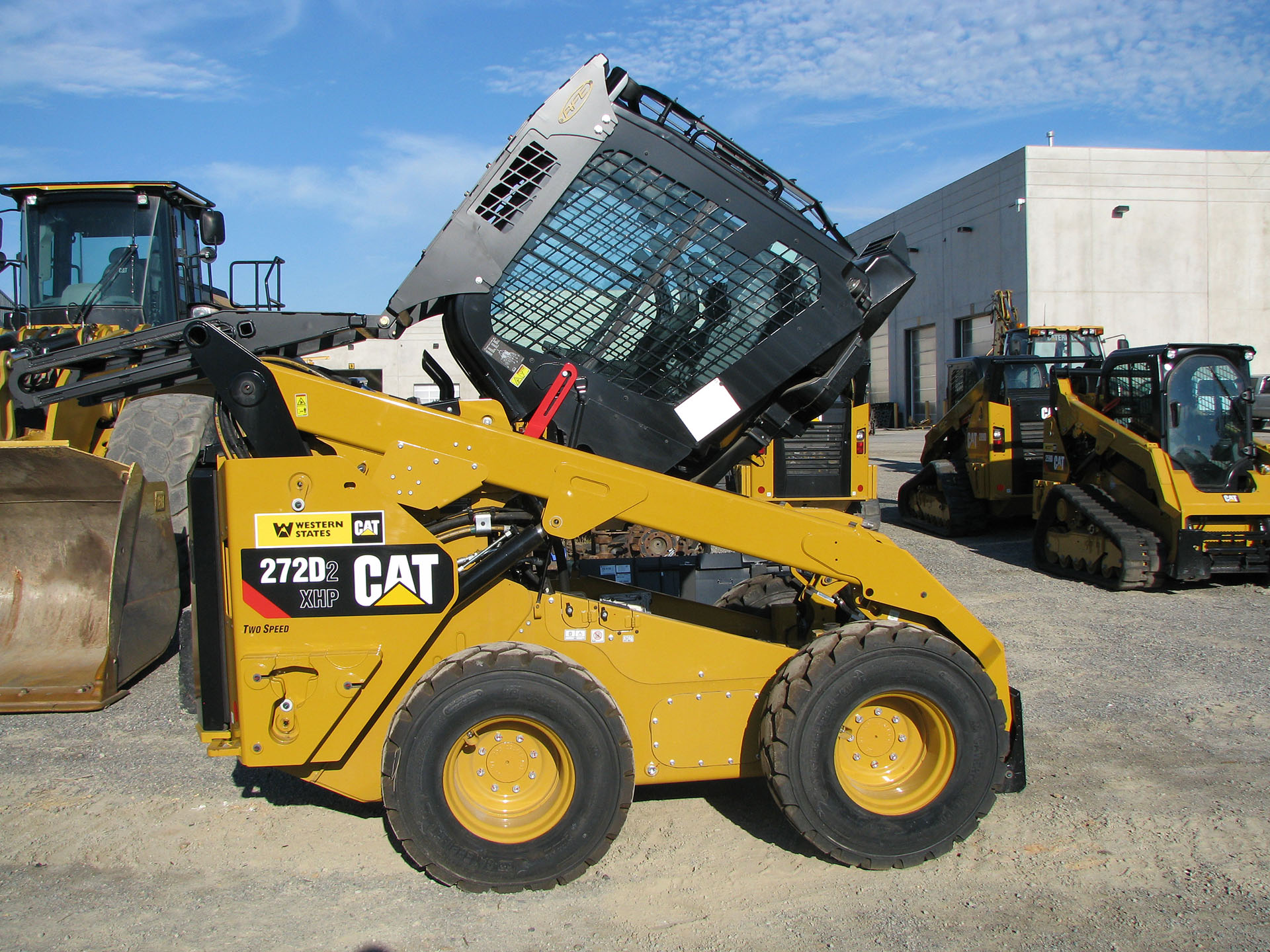 CAT 272D2 Skid Steer with 5x5 Skeleton Door