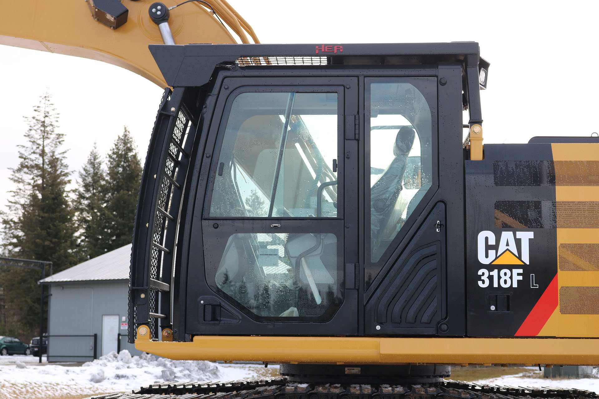 CAT 318FL with Bolt on Excavator Guard