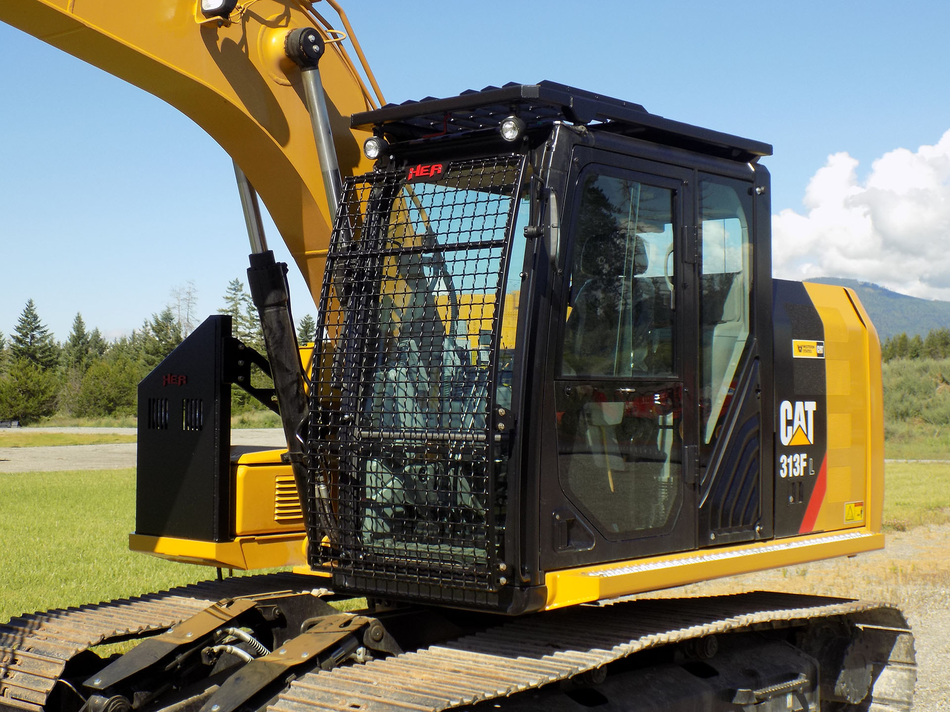CAT 313F with Bolt on Excavator Guard