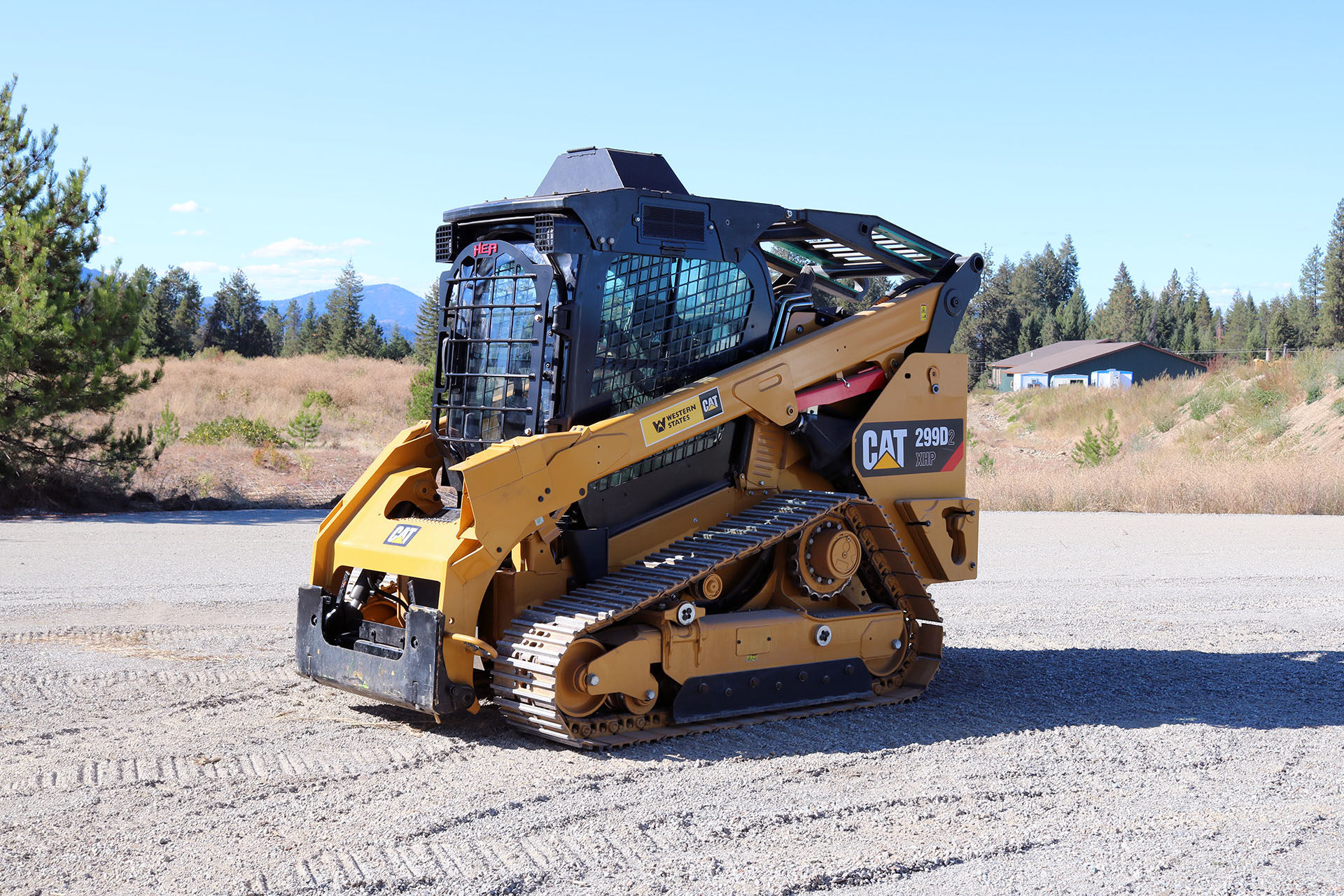 CAT 299D2 XHP Skid Steer with 5x5 Skeleton Door