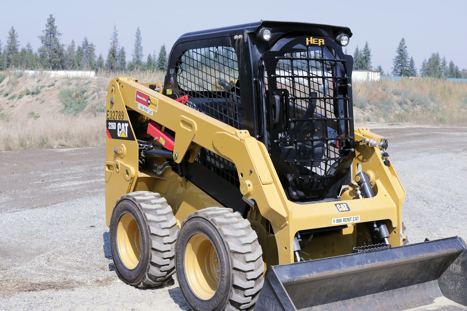 CAT 226D Skid Steer with 5x5 Skeleton Door