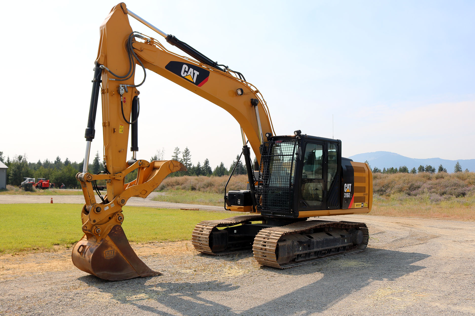 CAT 316E with Bolt on Excavator Guard